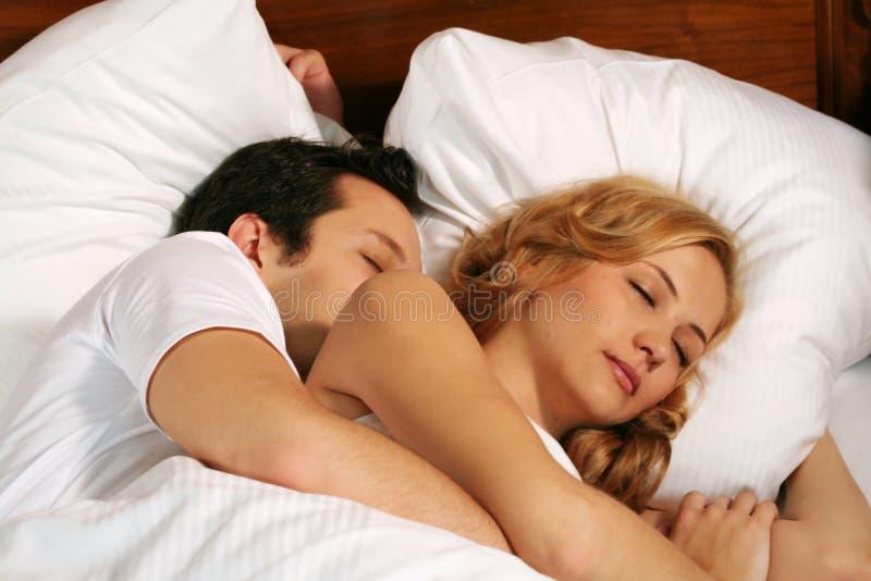 Sleeping young couple stock images