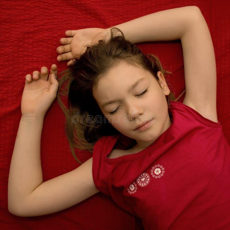 Sleeping young girl stock photo