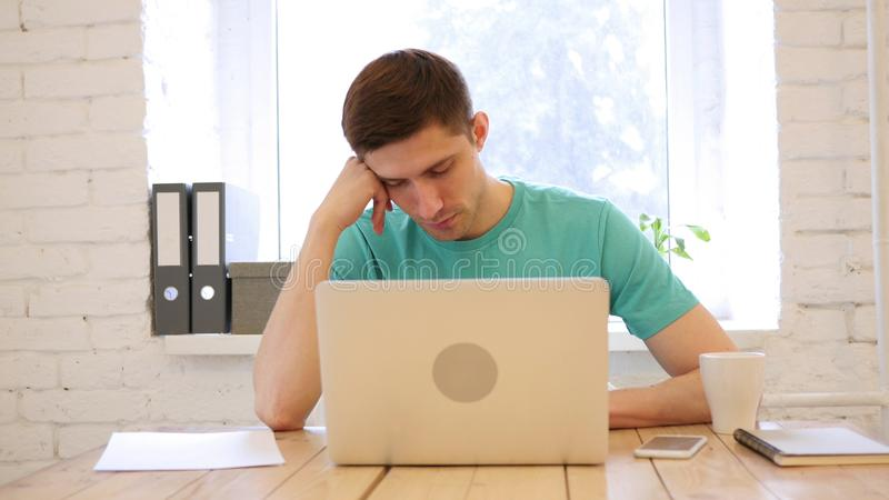 Sleeping Young Man on Desk in Office royalty free stock photos