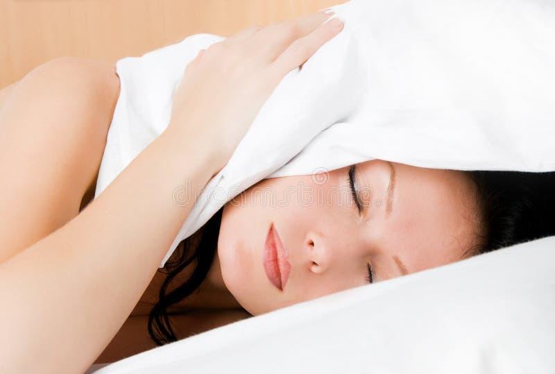 Sleeping young woman royalty free stock photos