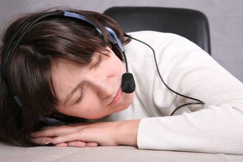 Sleepingg call service agent. In white close-up stock images