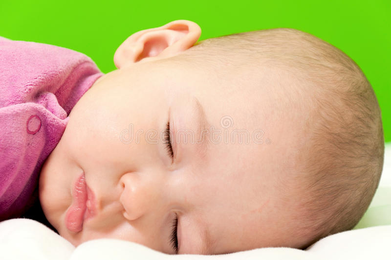 Sleepy baby girl stock image