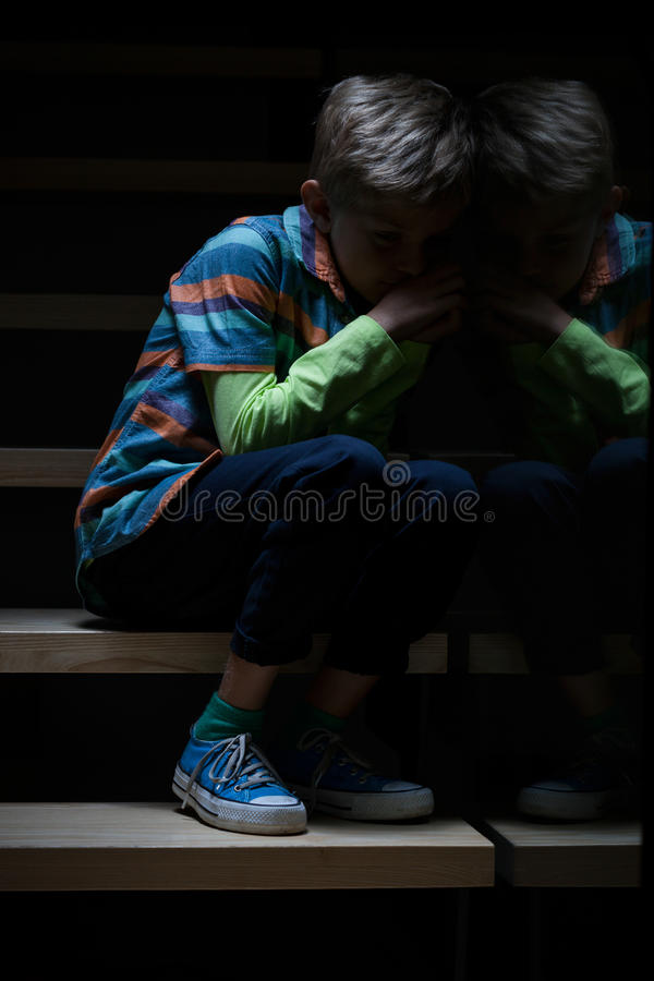 Sleepy boy on stairs at night royalty free stock photos