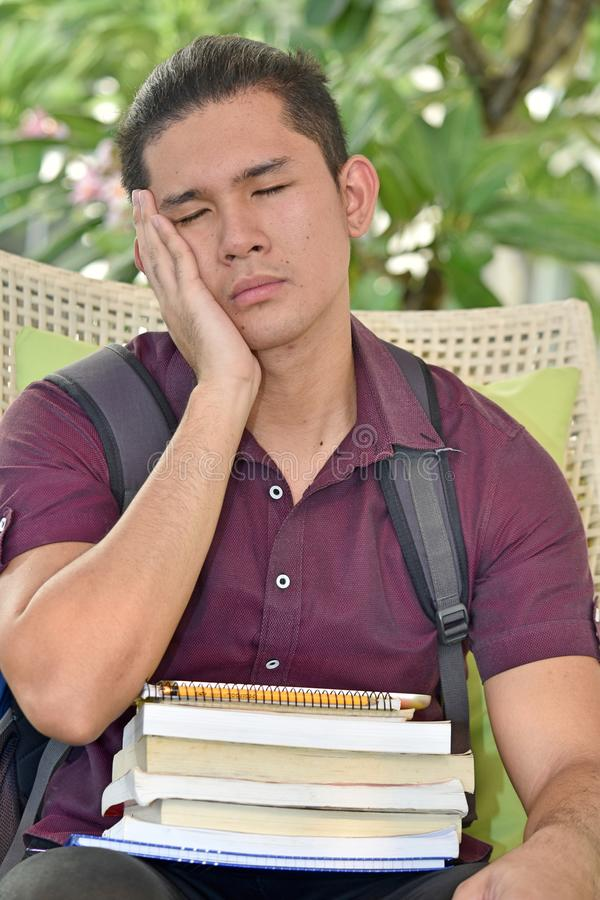 Sleepy Boy Student With Books. An attractive and asian person royalty free stock images