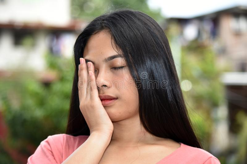 A Sleepy Female Woman. An attractive and asian person royalty free stock photos