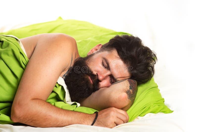 Sleepy and lazy person slowly posing alone. Man sleep in bed alone. Boy sleeping and dreaming. Joyful man sleeping on a. Bed stock photos
