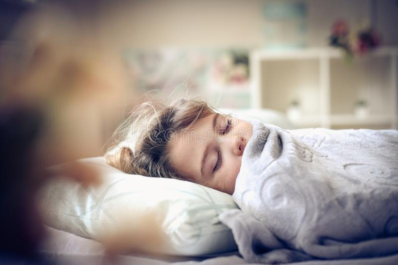 Sleepy little girl. Little girl sleeping in bed. Space for copy stock photo