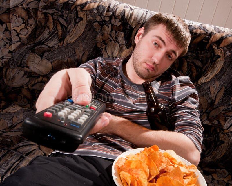 Download Sleepy man watching TV stock photo. Image of home, beer - 18451532