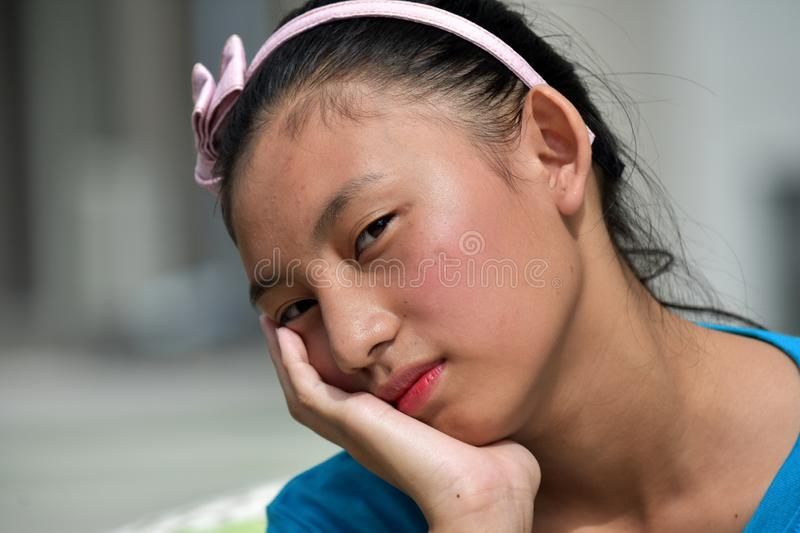 A Sleepy Teenage Female. An attractive and asian person royalty free stock photo