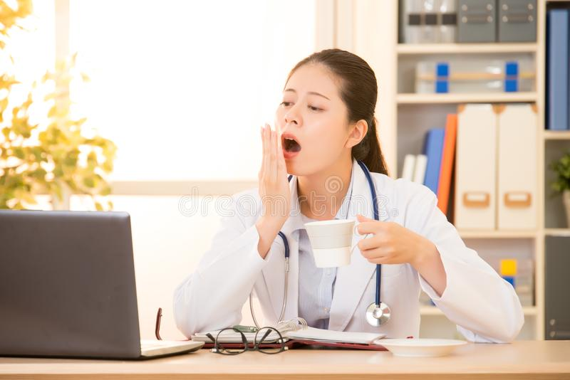 Sleepy and tired doctor with coffee royalty free stock photos