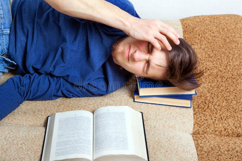 Tired Man with a Book stock photo