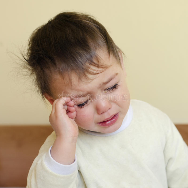 Crying sleepy child royalty free stock photography