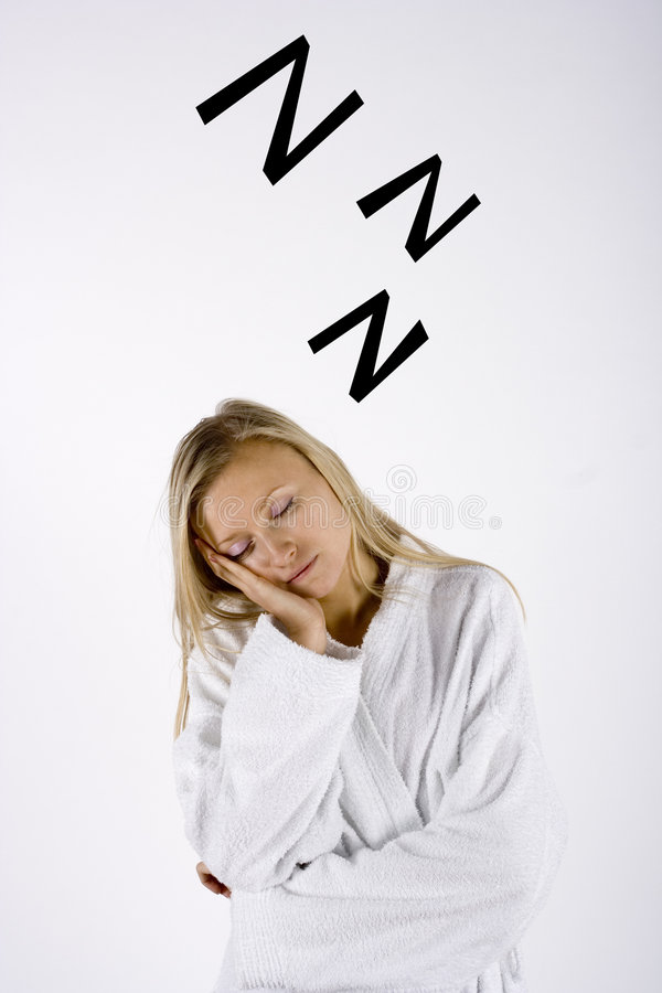 Sleepy Woman. Woman dressed in white in a standing position, with her head tilted into her flat palm. Her eyes are closed. Zs floating above her head. Isolated stock image