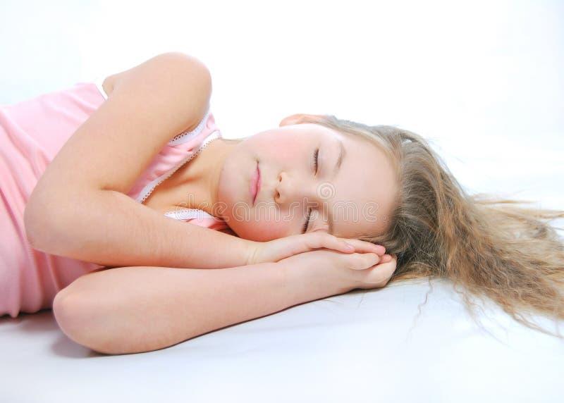 Sleepyhead. The sleeping girl on a white background stock photo