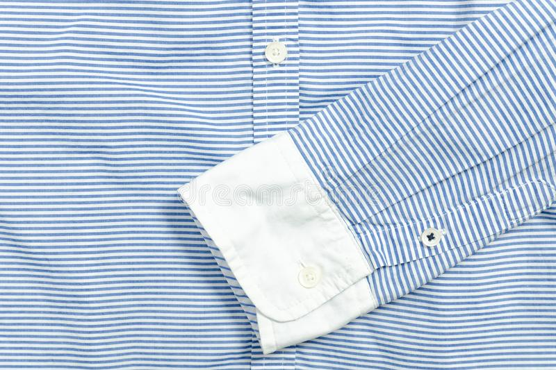 Sleeve of blue and white striped shirt. Detail. royalty free stock photo