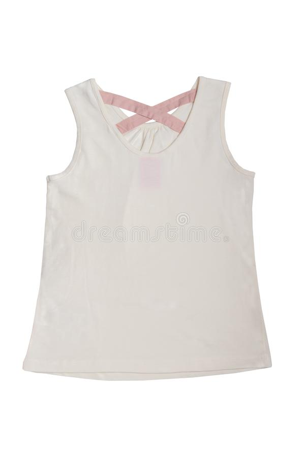 Sleeveless koszula odizolowywaj?ca Be?owa dziecko dziewczyny koszula lub koszulka z r??owymi faborkami na plecy odizolowywaj?cym  zdjęcie royalty free