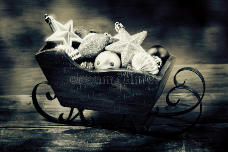 Sleigh full of Holiday ornaments stock photos
