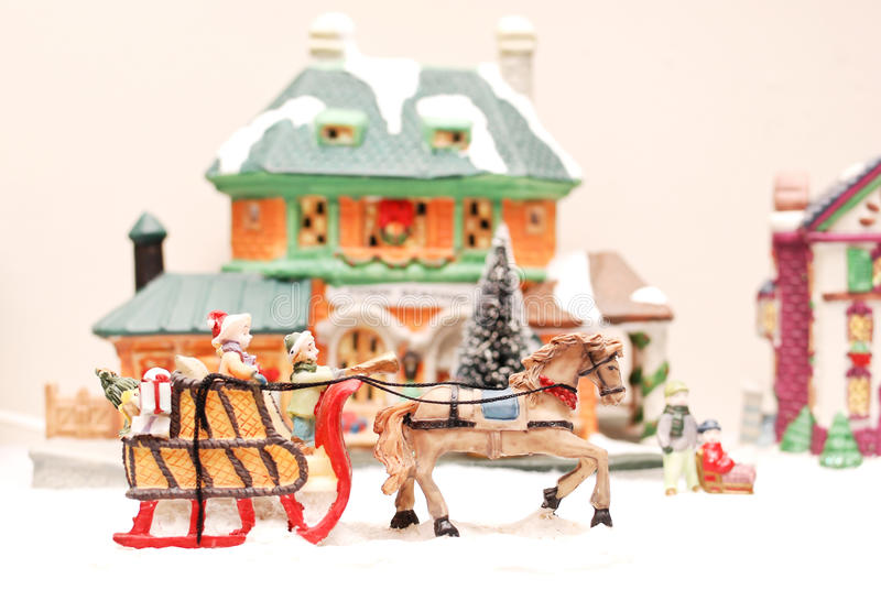Sleigh Ride. Hand Painted Town Miniatures With Horse Drawn Sleigh royalty free stock photography
