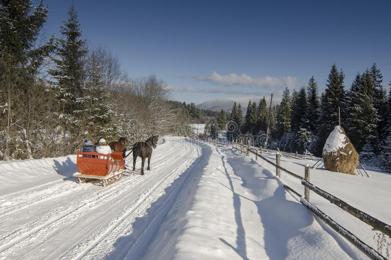 Sleigh rides in the winter are fun and healthy outdoor activities stock photos