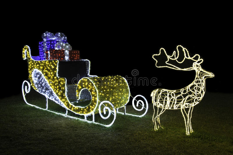 Sleigh of Santa Claus. Wonderful sleigh of Santa Claus made with lots of colored lights royalty free stock photos