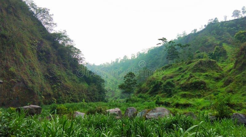 Hargobinangun Green Valley. SLEMAN, INDONESIA, NOVEMBER 11, 2018 : The scenery of the hargobinangun hill is very beautiful, very wide and naturally green. The royalty free stock photo