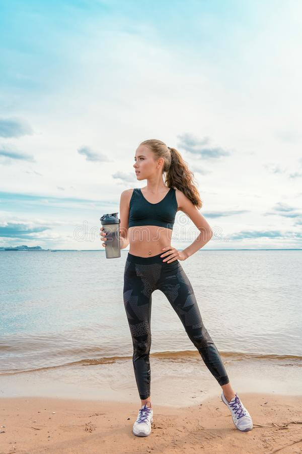Slender athletic girl in sports clothes stock photos