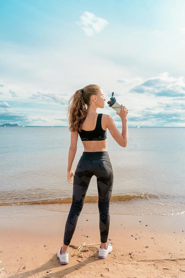 Slender athletic girl in sports clothes royalty free stock image