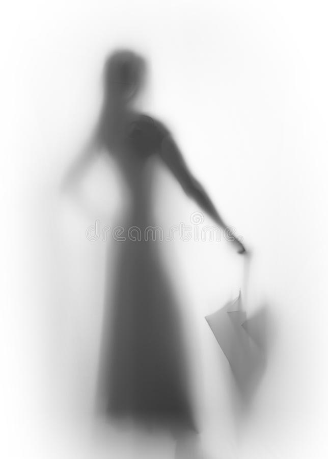 Beautiful slim woman body silhouette with umbrella. Slender female human body shape can be seen behind a curtain stock photography