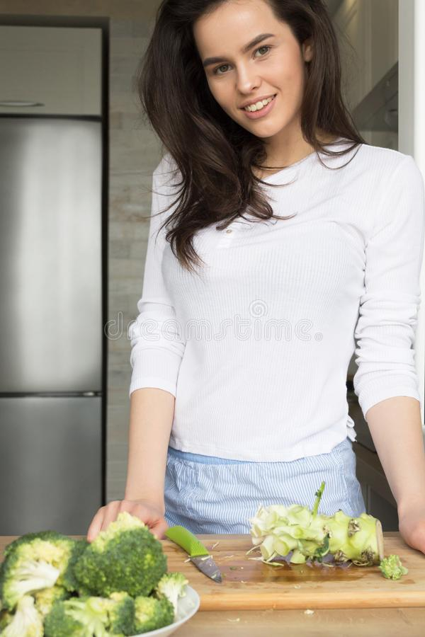 Beautiful Girl Preparing Broccoli. Losing weight. Nutrition stock photos