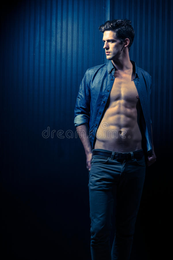 Slender Male Washboard Abs. Slender Male With Shirt Open Exposing Washboard Abs royalty free stock image