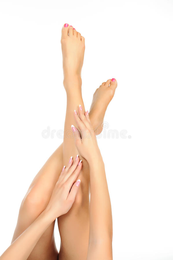 Free Slender Naked Female Legs Being Massaged Isolated Royalty Free Stock Images - 24553969