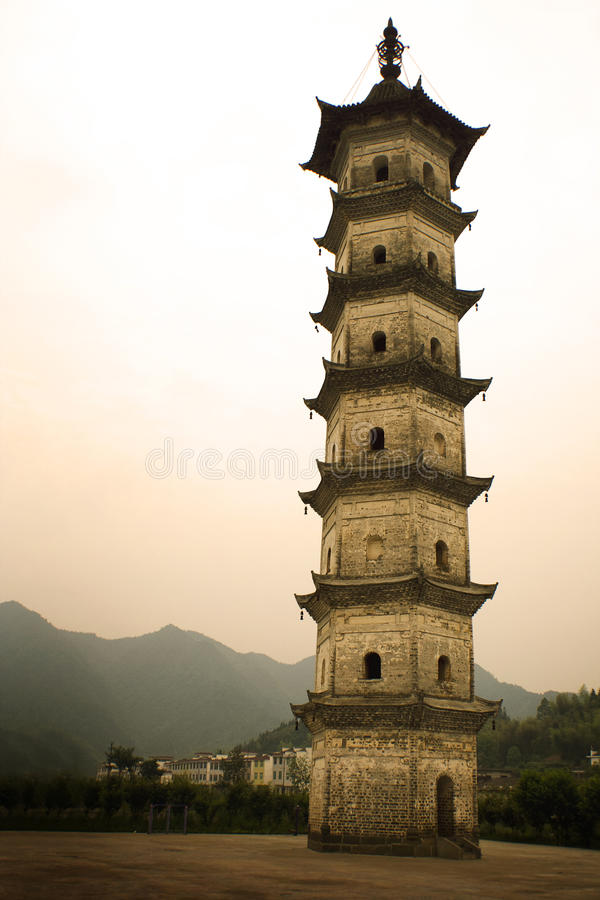 Slender pagoda in southern chinese village royalty free stock images