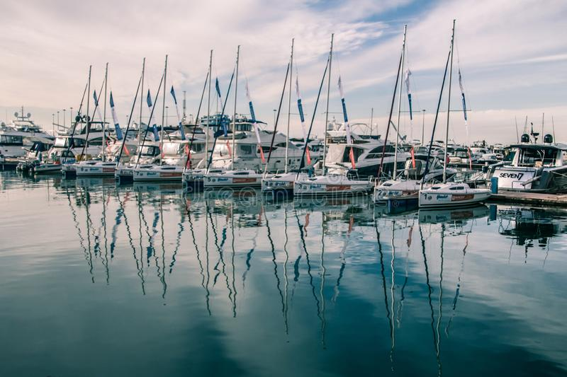 A slender row of yachts in the port of Sochi. royalty free stock photography