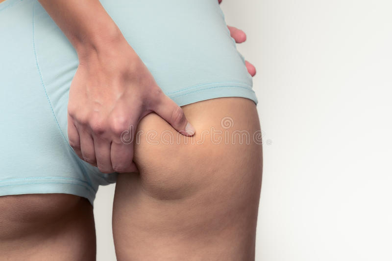 Slender young woman checking for excess weight royalty free stock photo