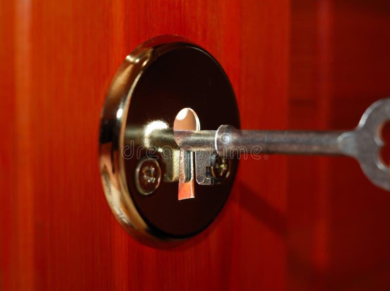 Sleutel en sleutelgat stock afbeelding