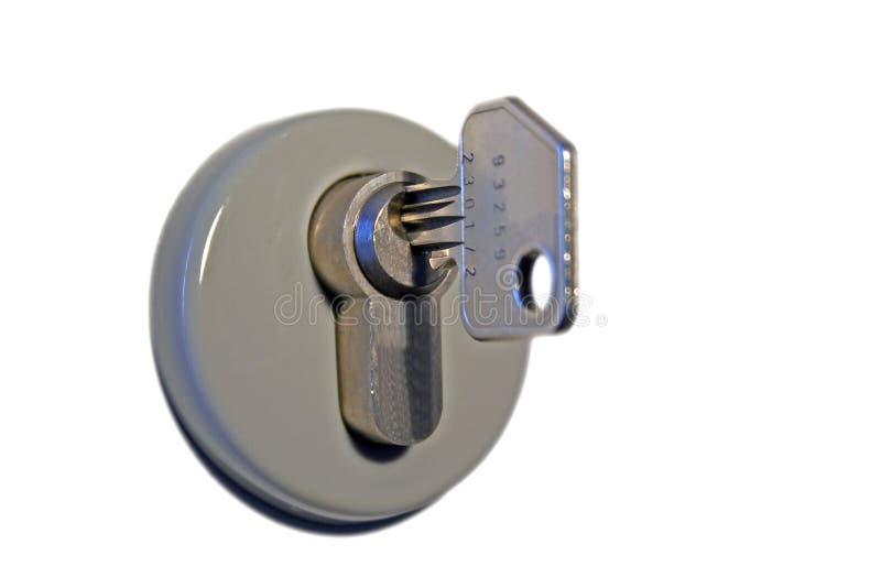 Sleutel in sleutelgat stock afbeelding