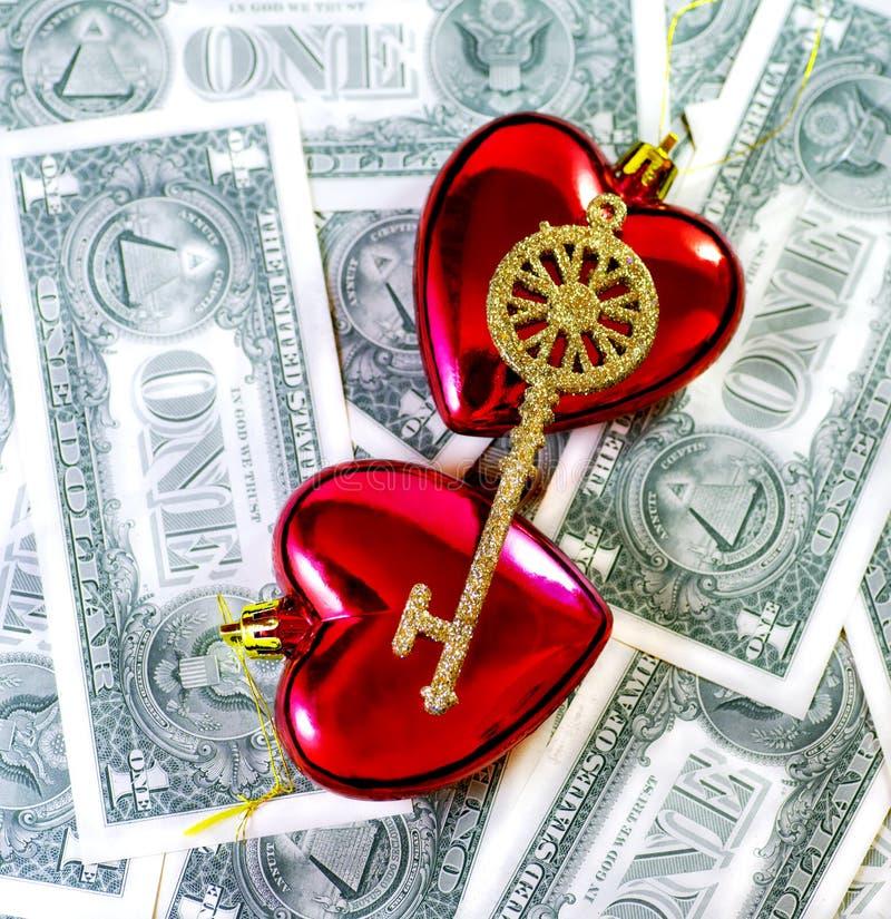 Sleutel tot Liefde, hart en geld royalty-vrije stock foto