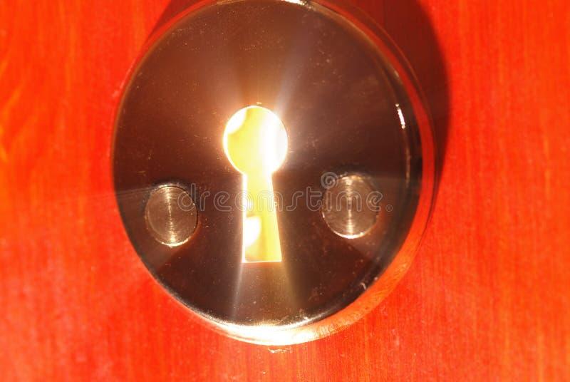 Sleutelgat met licht stock foto