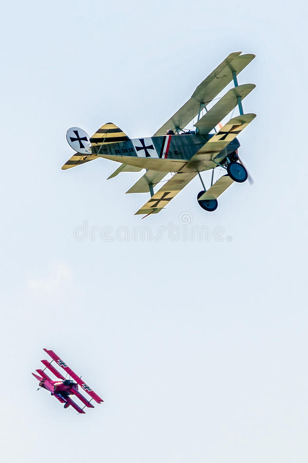Dogfight versus triplanes. SLIAC, SLOVAKIA - AUGUST 27: Dogfight between triplanes at airshow SIAF 2017 on August 27, 2017 in Sliac royalty free stock photos