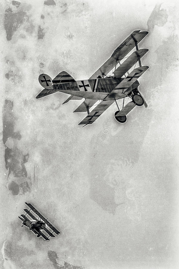 Dogfight versus triplanes. SLIAC, SLOVAKIA - AUGUST 27: Dogfight between triplanes at airshow SIAF 2017 on August 27, 2017 in Sliac royalty free stock photography