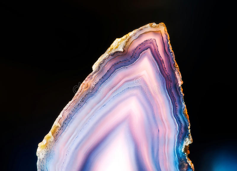 Slice of agate. Translucent flat slice of purple agate royalty free stock photos