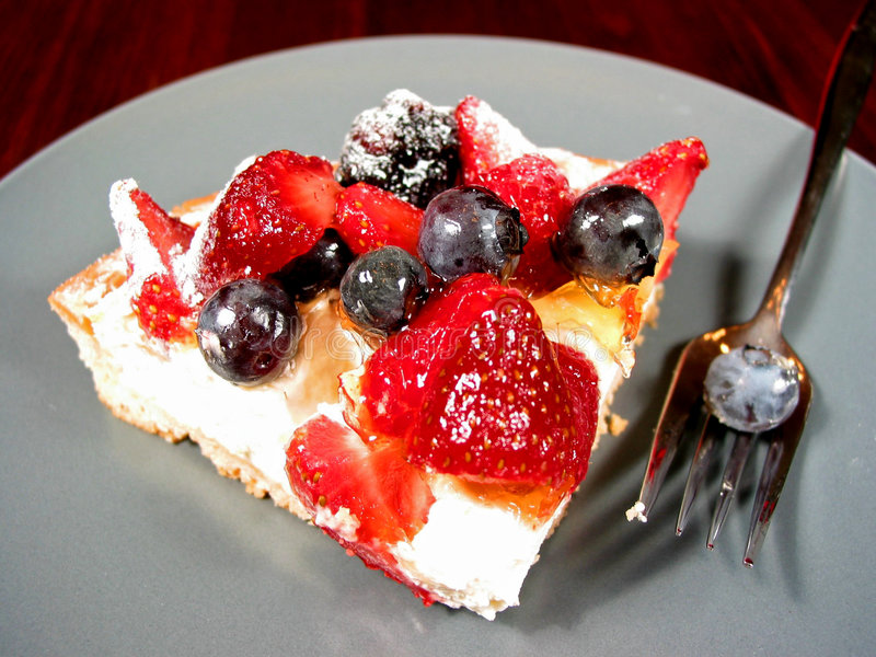Slice of berry cake royalty free stock images