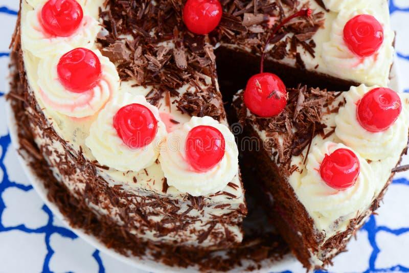 Slice of blackforest cake gateau stock photos