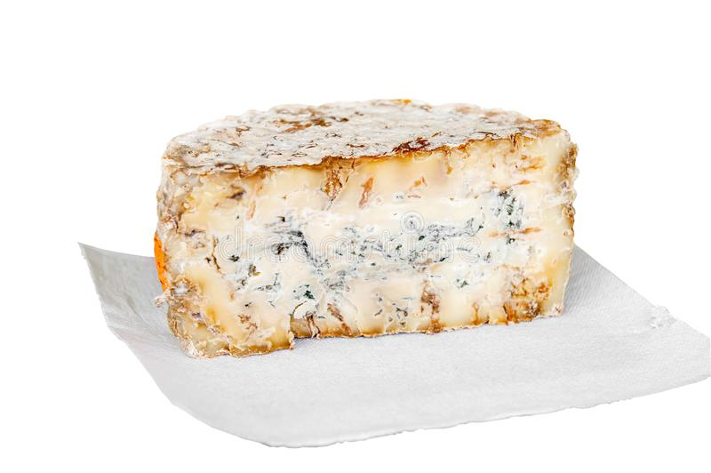 A slice of blue aged delicatessen Stilton cheese on a piece of white paper. Farm quality products.  stock photo