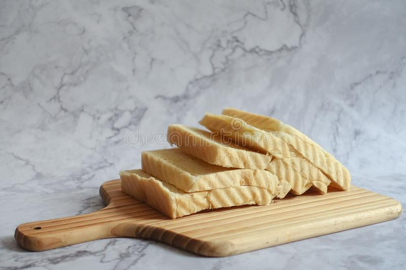 Slice Bread on Brown Chopping Board royalty free stock image