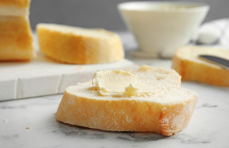 Slice of bread with butter on marble stock photos