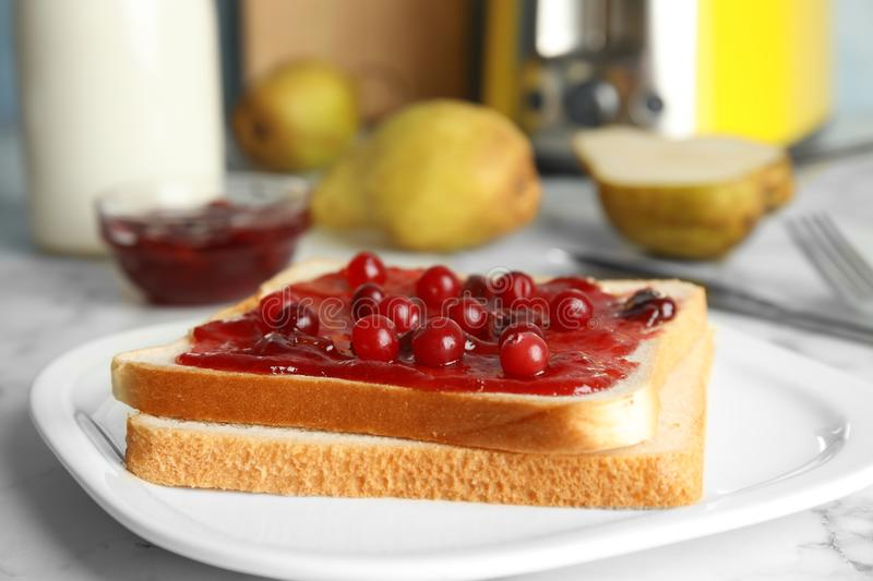 Slice of bread with jam stock photography