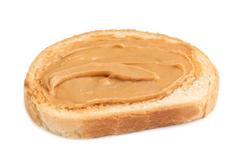 Slice of bread with peanut butter royalty free stock images