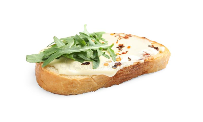 Slice of bread with spread and arugula royalty free stock image