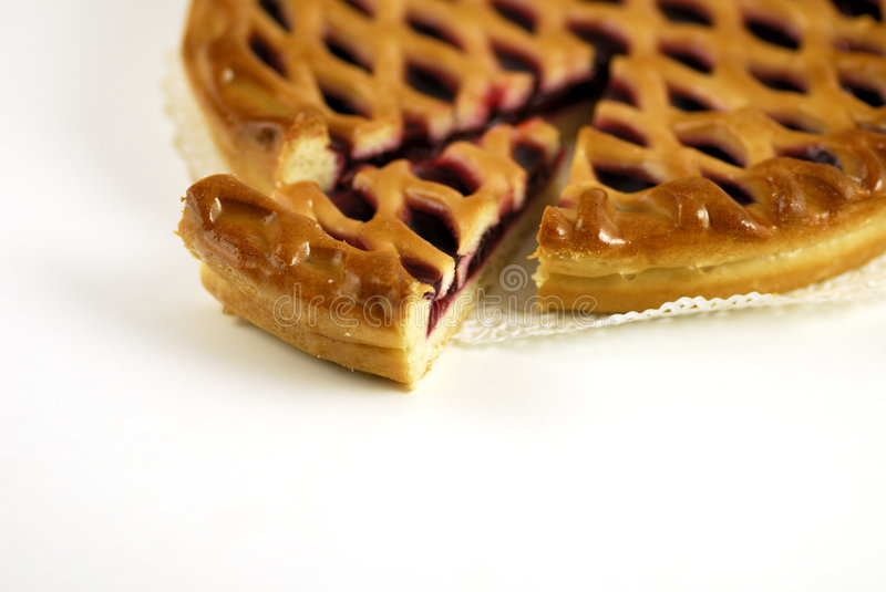 Slice of a cherry pie royalty free stock images